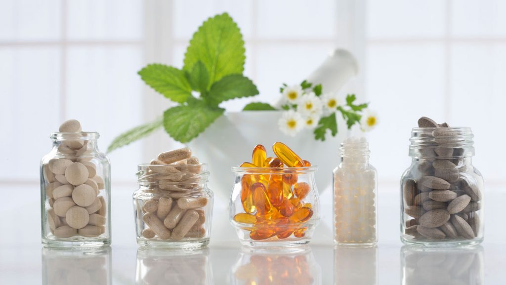Supplements in glass bottles.