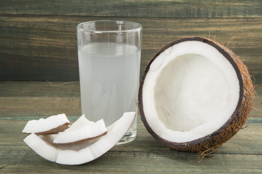 Coconut water on the wooden background