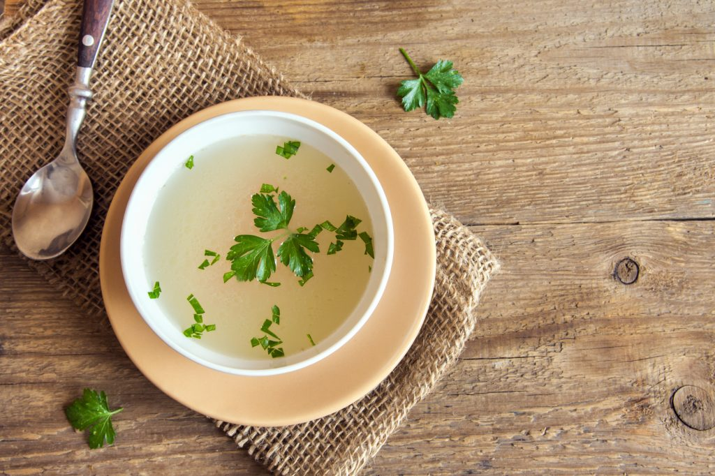 Bone broth in a bowl with parsley