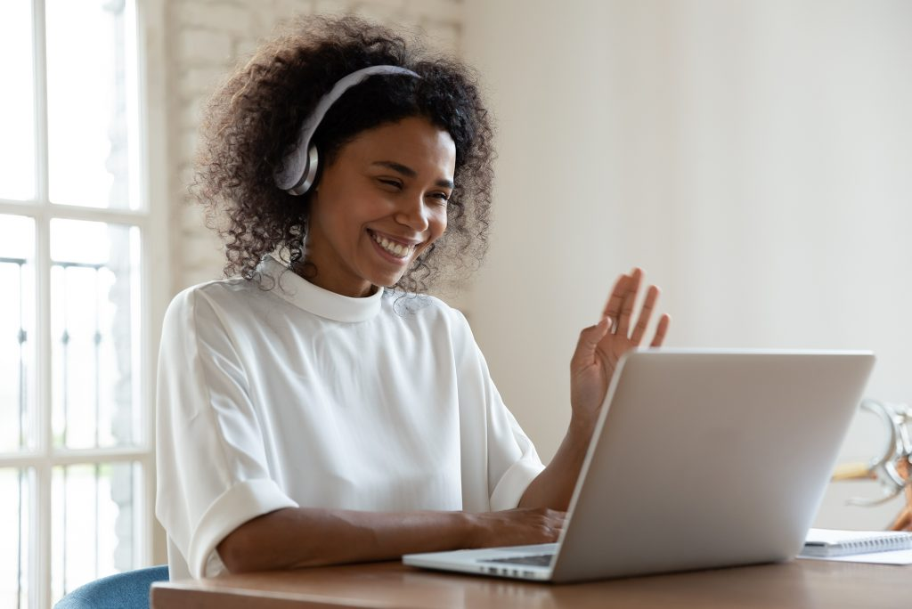 Woman on a video chat with coworkers